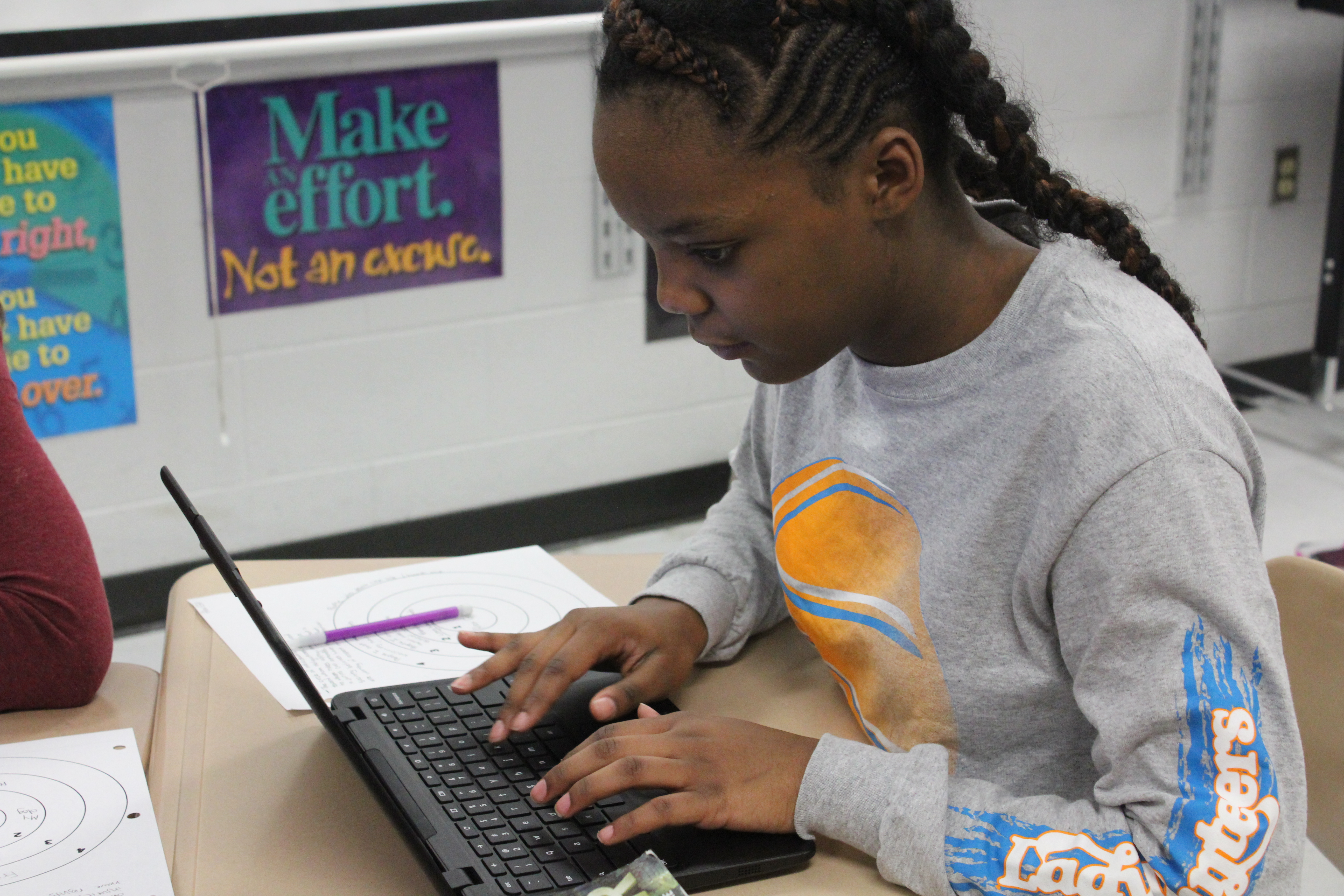 T.W. Hunter student uses a computer to work on an assignment