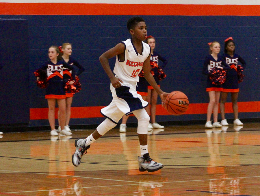 RJ Moore brings the ball up the court!