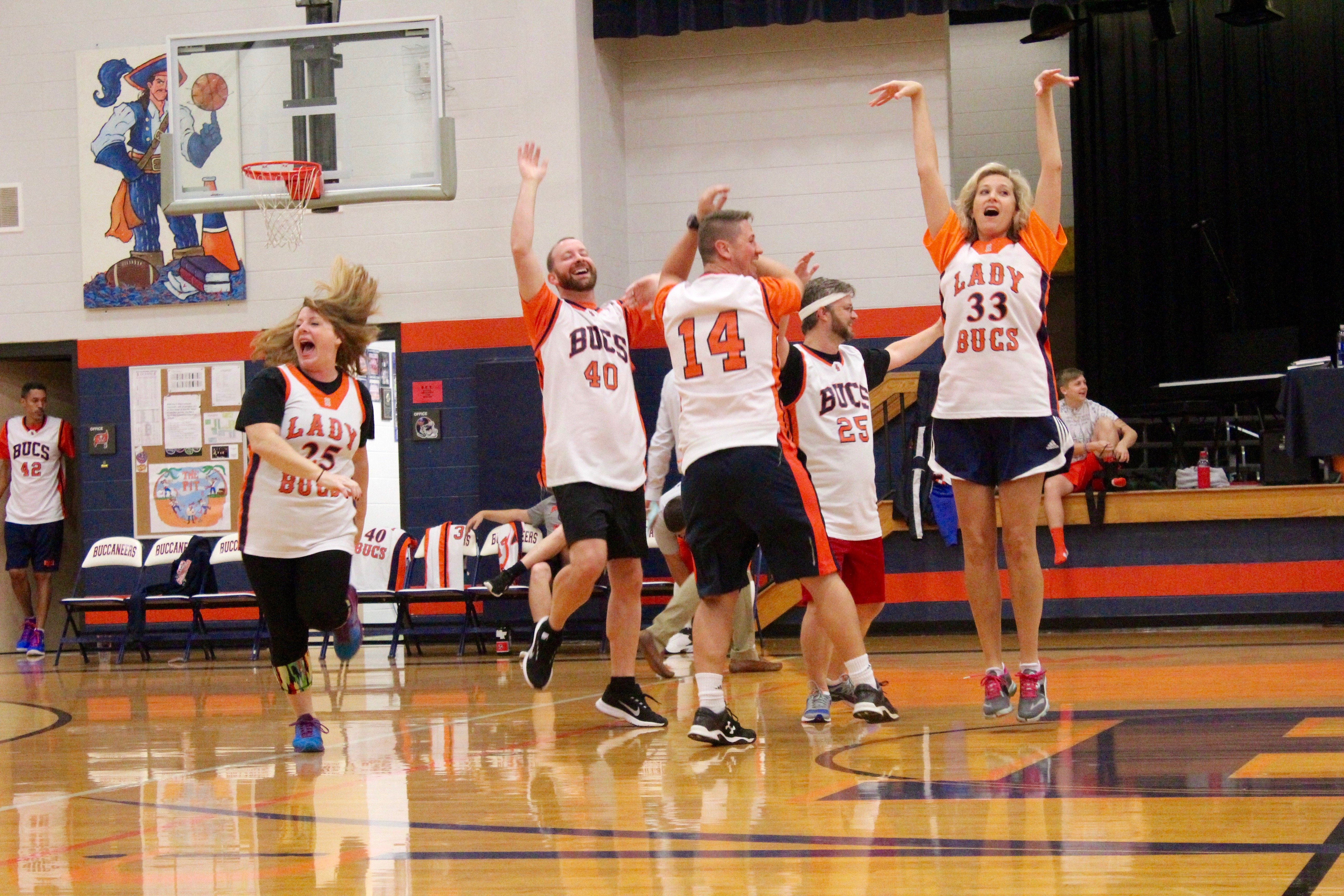 Teachers Celebrate Victory in the Student-Teacher Basketball Game